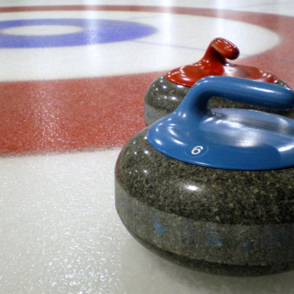 Curling_stones_on_rink_with_visible_pebble(1)